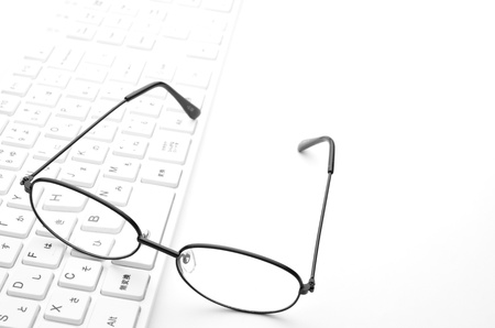 Glasses and keyboard photo