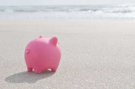 piggy bank on beach Stock Photo
