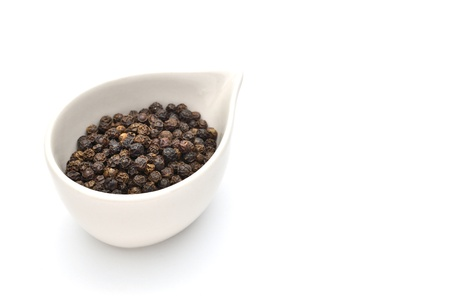 Black pepper isolated on white background photo
