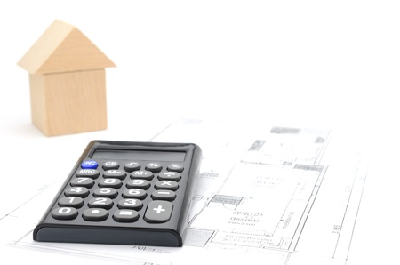Model house and calculator on construction plan Stock Photo - 18674884