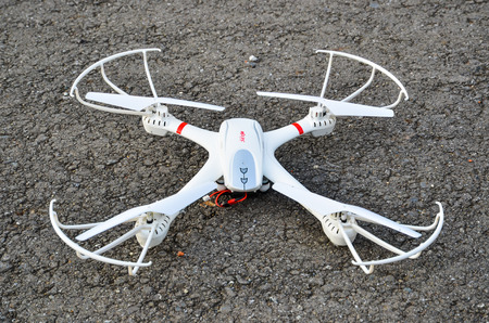 white drone on the ground Stock Photo