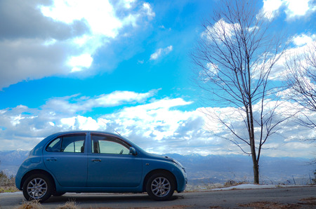 little car with blue sky