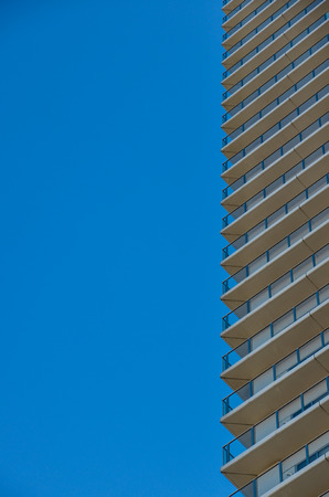 vertical wall into blue sky