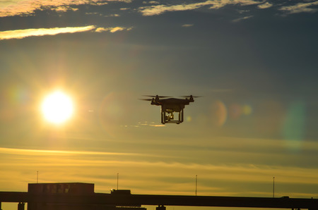 flying drone in sunset Stock Photo