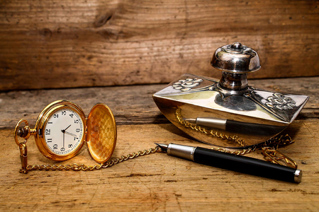 old elegance - pocket watch and fountain pen