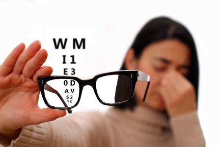 Vision disorder - vision problems - blurred vision. Young woman with glasses.