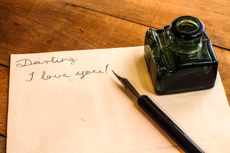 Fountain pen and ink bottle. Love letter. Stock Photo - 94404328