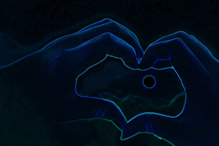Abstract hand in the shape of a heart on the background Stock Photo