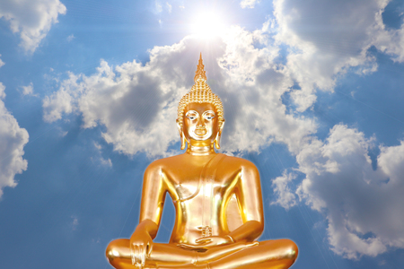 Golden Buddha from Thailand on sky background Banco de Imagens