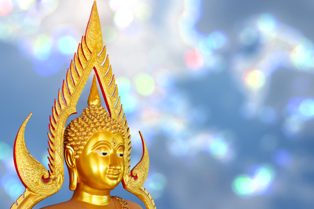 Golden Buddha from Thailand on bokeh background