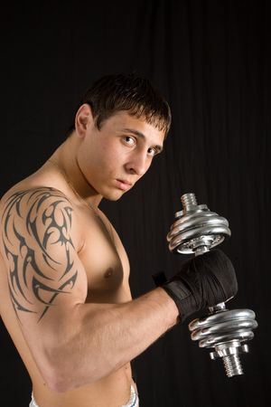Portrait of a young man with the barbell. Stock Photo - 4420681