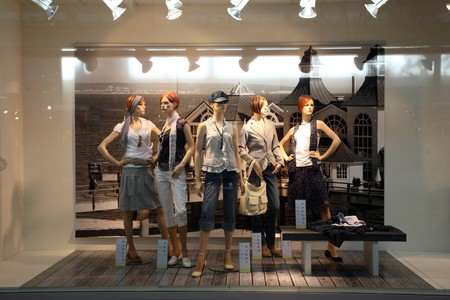 window display: Female mannequins in clothing store.