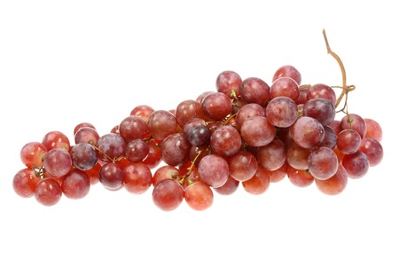 Red grapes on a white background. Imagens