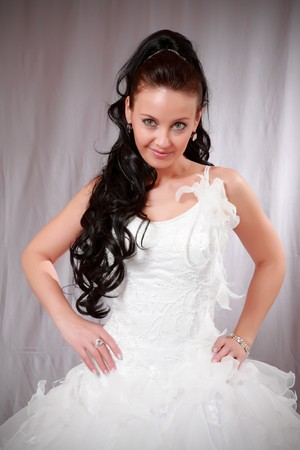 Beautiful young woman in wedding white gown. photo