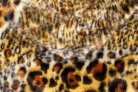 spotted fur: Surface of spotted, fake fur. Stock Photo