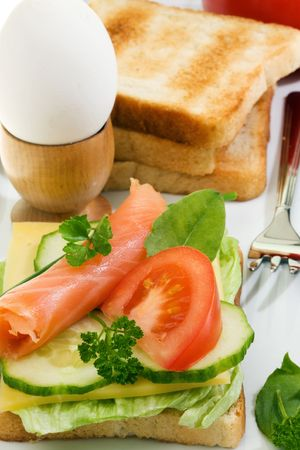 Toasts with salmon, cheese and vegetables. Stock Photo - 4680559