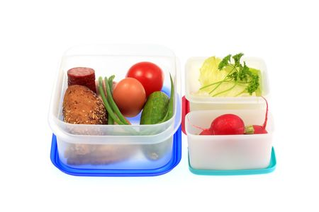 Plastic lunch boxes on a white background. Stock Photo
