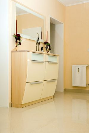entryway: Shoe cabinet in the entryway. Stock Photo