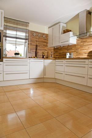 tiles floor: Modern kitchen interior in new home.
