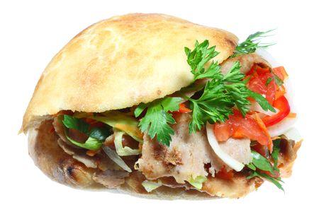 pinchos morunos: D�ner kebab en un fondo blanco.