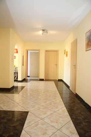 tile floor: Modern hall in a new home.