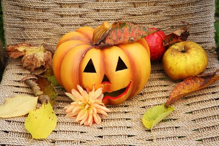 Halloween pumpkin with fruit and leaves. photo