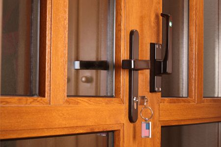 Modern front door and the key with tag such as US flag.