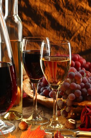 Red and white wine, fruits, chocolate and flowers.