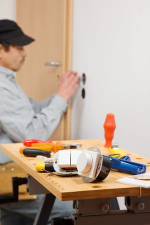 Electrician installing dimmer and a light switch. Stock Photo