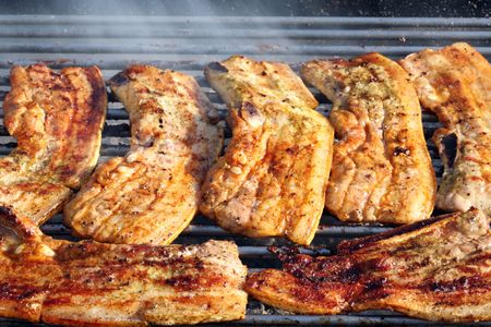 Barbecued steak on the grill. Stock Photo - 6562149