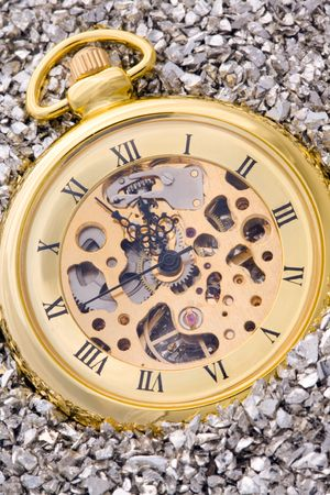 Antique mechanical pocket watch on silver nuggets. photo