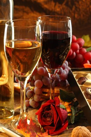 Red and white wine, fruits and rose. Stock Photo