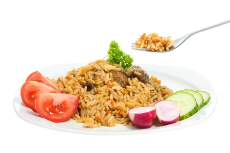Plate of pilaf isolated  on a white background.