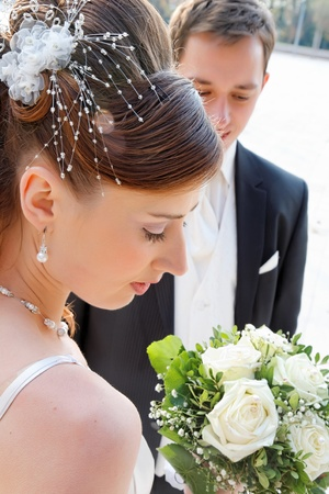 Pretty bride with wedding bouquet. Stock Photo