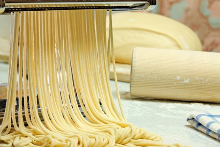 Simple homemade noodles and pasta machine. photo