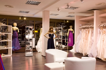 beauty shop: Mannequins in wedding and evening gowns in the bridal shop.