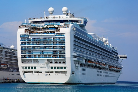 KUSADASI, TURKEY - SEPTEMBER 21: Grand-class cruise ship Ruby Princess at the harbor on September 21, 2011 in Kusadasi, Turkey. The ship was built in 2008 and costed about 400 million dollars. It has 19 decks for more than 3000 passengers and 1200 crew me Stock Photo - 10950267