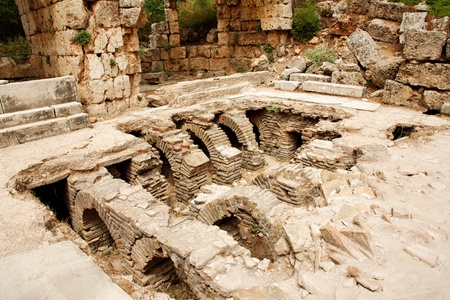 Ruins of ancient public Roman baths in Perge, Antalya, Turkey Stock Photo