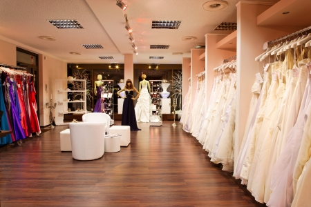 Mannequins in wedding and evening gowns in the bridal shop. photo