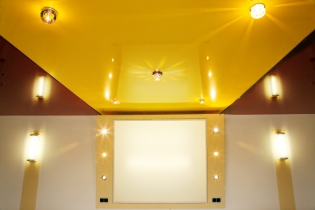 Pvc stretch ceiling film with halogen lamps. Stock Photo
