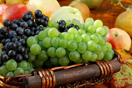 Basket of ripe fruits on the table. photo