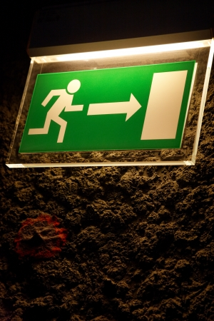 Lighted Emergency exit sign in the grotto.