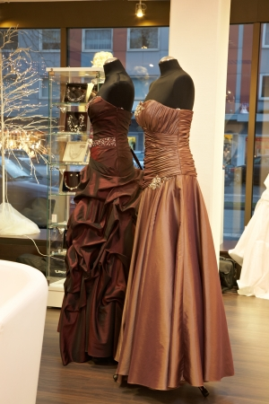 evening gowns: Mannequins in wedding and evening gowns in the bridal shop