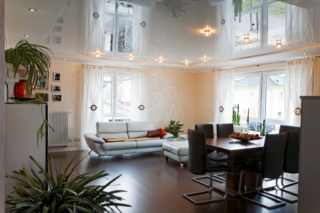 Living room with halogen lighting on a PVC ceiling