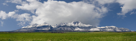 Extra wide panorama of High Tatra mountains during April with snowy hills Vysoke Tatry Slovakia