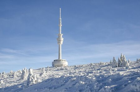 Praded peak with transmiter covered by ice in winter time, Jeseniky, Czech Republic Imagens