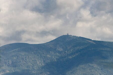 Lysa peek with transmitter, Beskydy mountains during summer with cloudy sky Banco de Imagens