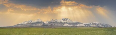 Extra wide panorama of High Tatra mountains with snowy hills Vysoke Tatry Slovakia, golden hours