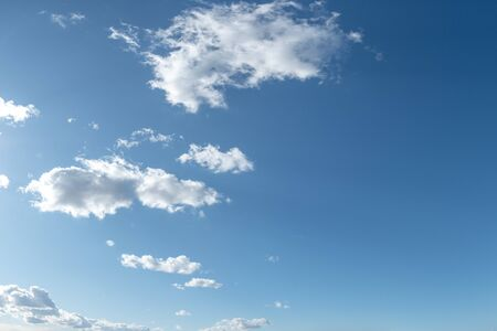 A blue sky with beautiful large fluffy clouds