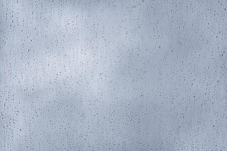 Raindrops on the window during storm Фото со стока